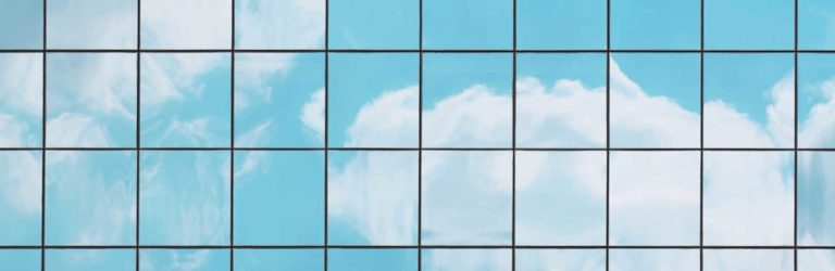 Clouds on office building