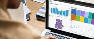 Man using IBM Planning Analytics on a laptop