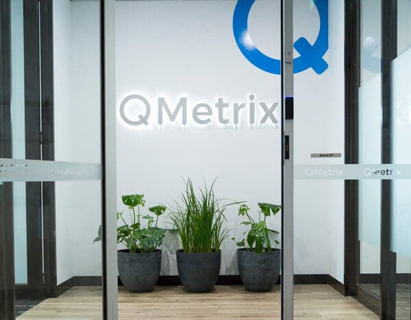 QMetrix office entrance with logo and plants